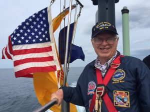 Photo of Dick Brown on top of the sail of USS New Mexico