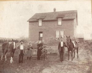 Photo of Yott family and house.